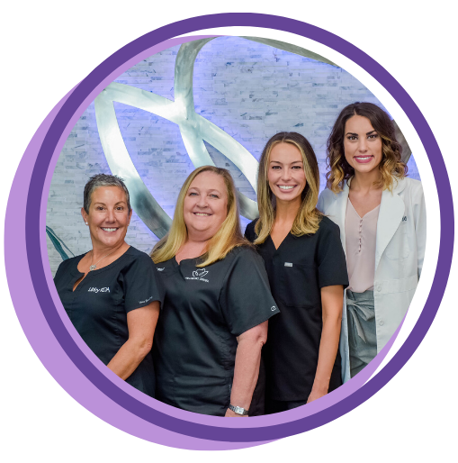 Hillsboro Dental team in a purple frame
